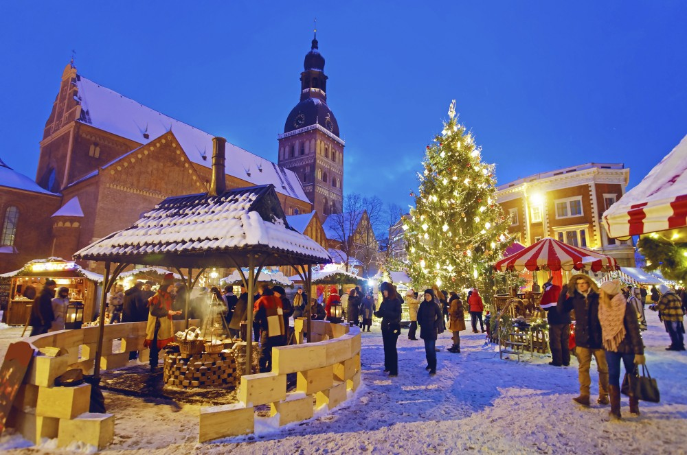 RIGA, LATVIA - DECEMBER 28, 2014: People enjoy Christmas market in Riga's Old Town on December 28, 2014, Latvia. It is the oldest Christmas Market with a very long history